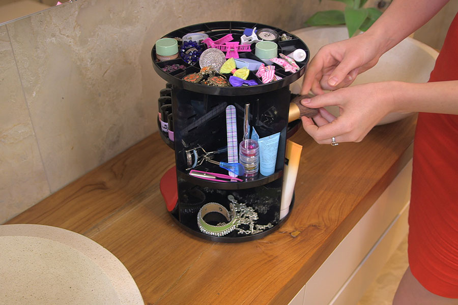Easily store your bathroom toiletries and accessories in the spinning storage container in black or white